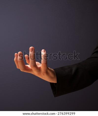 Businessman presenting empty space #276399299