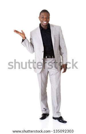 Businessman presenting something on his palm, isolated on white
