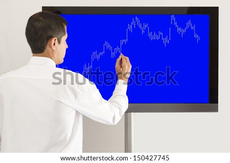 businessman presenting the graph of the market gains