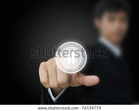 Businessman press pause button
