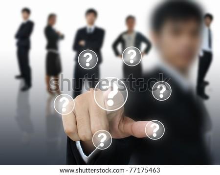 Businessman press question button