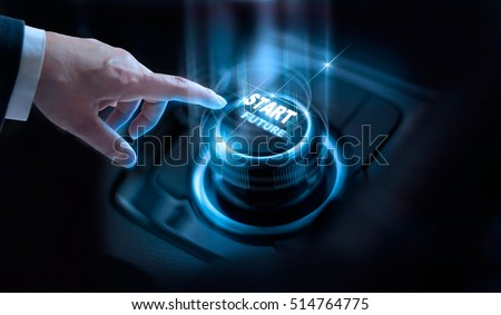 Businessman press start future button with virtual light in dark background