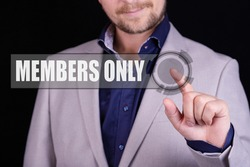 Businessman presses a button with the text MEMBERS ONLY. Business concept.