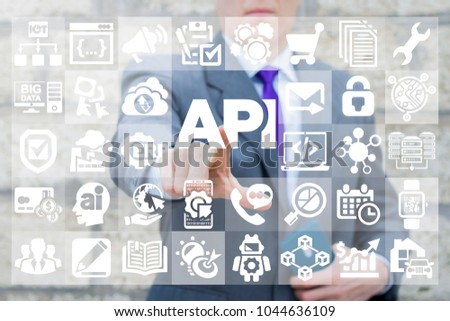 Businessman presses API text icon on a virtual interface. Application Programming Interface Business Internet Network Information Technology Computing Digital AI IOT BIG DATA Mobile concept.