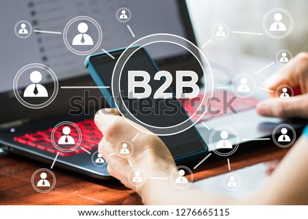 Businessman presses button b2b business-to-business icon on network virtual interface. Stockfoto ©