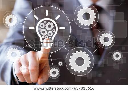 businessman presses button idea ...