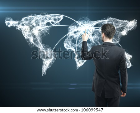 Businessman pressing a touchscreen Social Network button