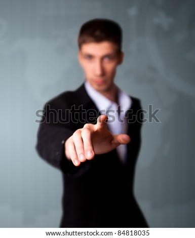 Businessman pressing an imaginary button on bokeh