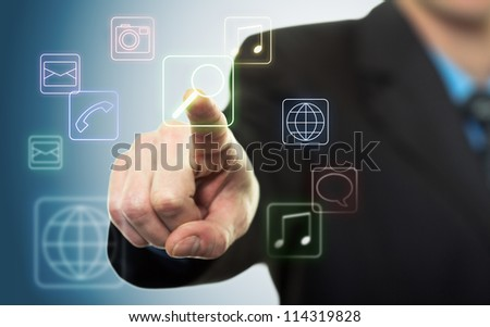 Businessman pressing application button on computer with touch screen