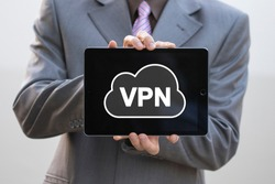 Businessman pressing button cloud vpn creation Internet protocols for protection private network on tablet.