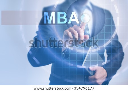 Businessman pressing button on touch screen interface and select MBA. Business, internet, technology concept. #334796177