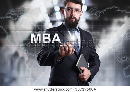 Businessman pressing button on touch screen interface and select MBA. Business, internet, technology concept. #337195004