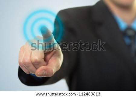Businessman pressing button on touch screen technology