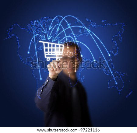 businessman pressing cart button on world map -  symbol of modern online marketing and shopping