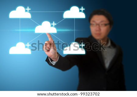 Businessman pressing cloud computing buttons on a touch screen