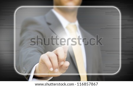 Businessman pressing digital screen