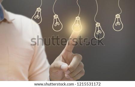 Businessman pressing light creative  idea Concept  idea and innovation #1215531172