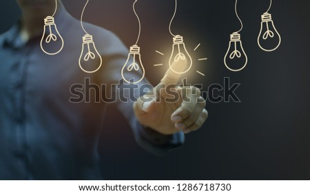Businessman pressing light creative  idea .Concept  idea and innovation #1286718730