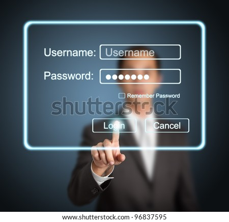 businessman pressing login button on internet sign in page on computer screen - stock photo