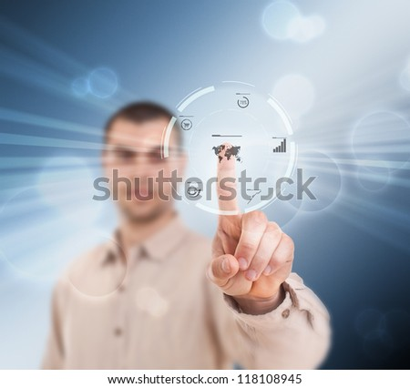 Businessman pressing modern buttons on a virtual background