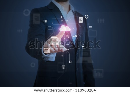 businessman pressing on cloud button on virtual screen over dark background