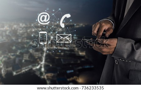 businessman pressing phone,company identification  / concept contact us
