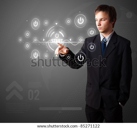 Businessman pressing simple start buttons on a virtual background