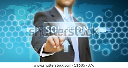 Businessman pressing solution button