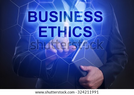 "Businessman pressing touch screen interface and select ""Business ethics"". #324211991"