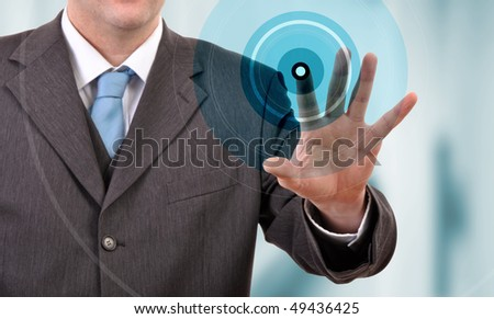 Businessman pressing touchscreen button