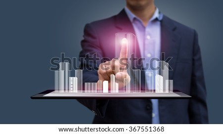 Businessman pressing virtual building on Tablet computer. Globalization. Technology and Communication.