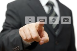 Businessman pressing virtual ( mail,phone,email ) buttons. customer support concept