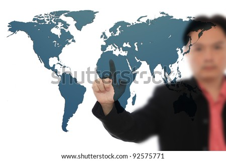 Businessman pressing world map