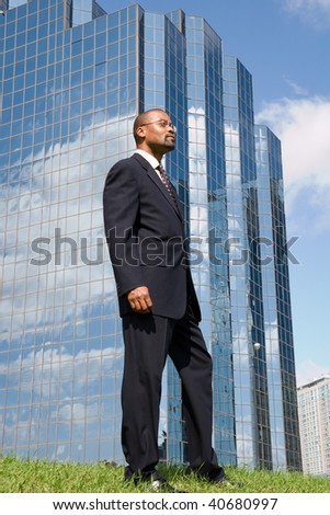 businessman profile with an office building in the background
