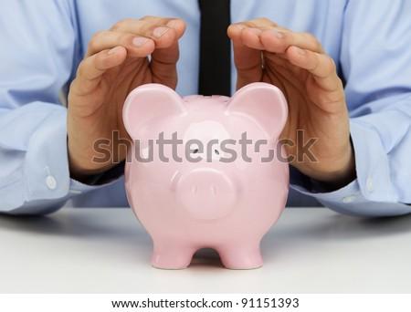 Businessman protecting his savings - stock photo