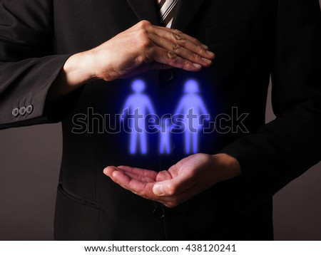 Businessman protecting with his hands a family icon #438120241
