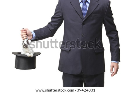 Businessman pulling a rabbit out of a silk top hat