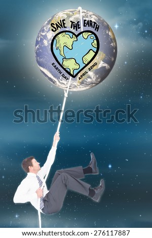 Businessman pulling a rope against stars twinkling in night sky