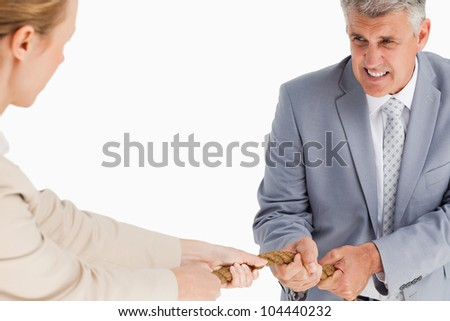 Businessman pulling a rope against white background