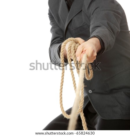 Businessman pulling on a rope. Isolated on white