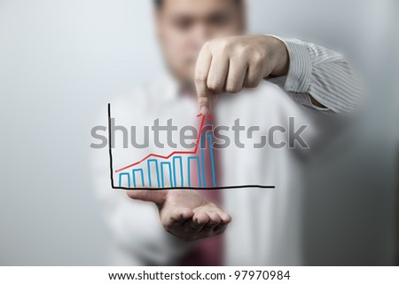 Businessman pulling up a graph