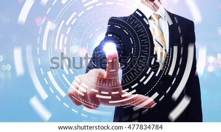 Businessman pushing a button on a digital touch screen #477834784