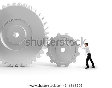 businessman pushing a gears to make it work