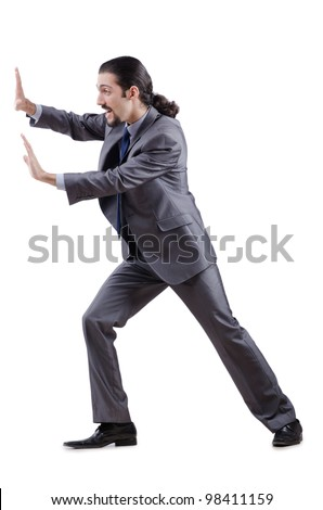 Businessman pushing away virtual obstacles - stock photo