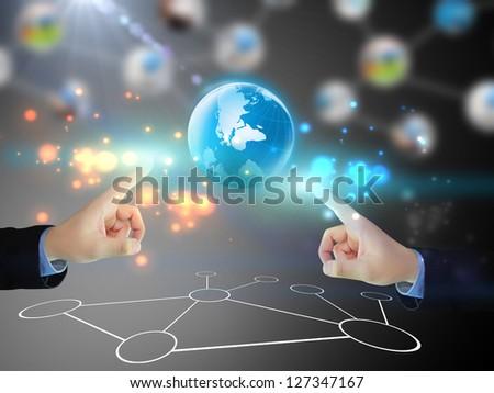 Businessman pushing business world