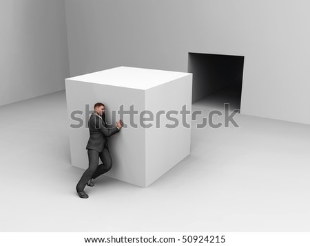 businessman pushing cube