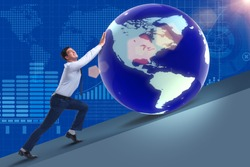 Businessman pushing earth in business concept