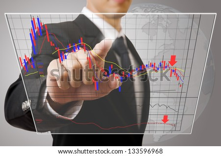 Businessman pushing finance graph for trade stock market on the Touchscreen Interface.