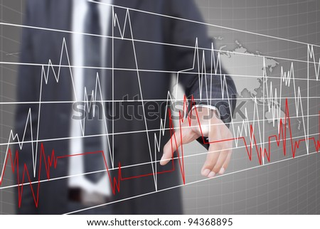 Businessman pushing graph for trade stock market on the whiteboard.