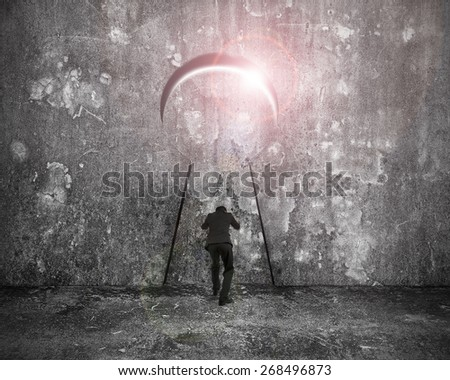 Businessman pushing keyhole door with bright sunlight on mottled concrete wall background